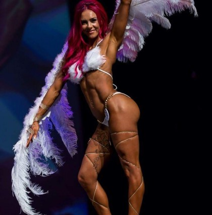Sarah P, our red-headed fitness model and muscle competitor